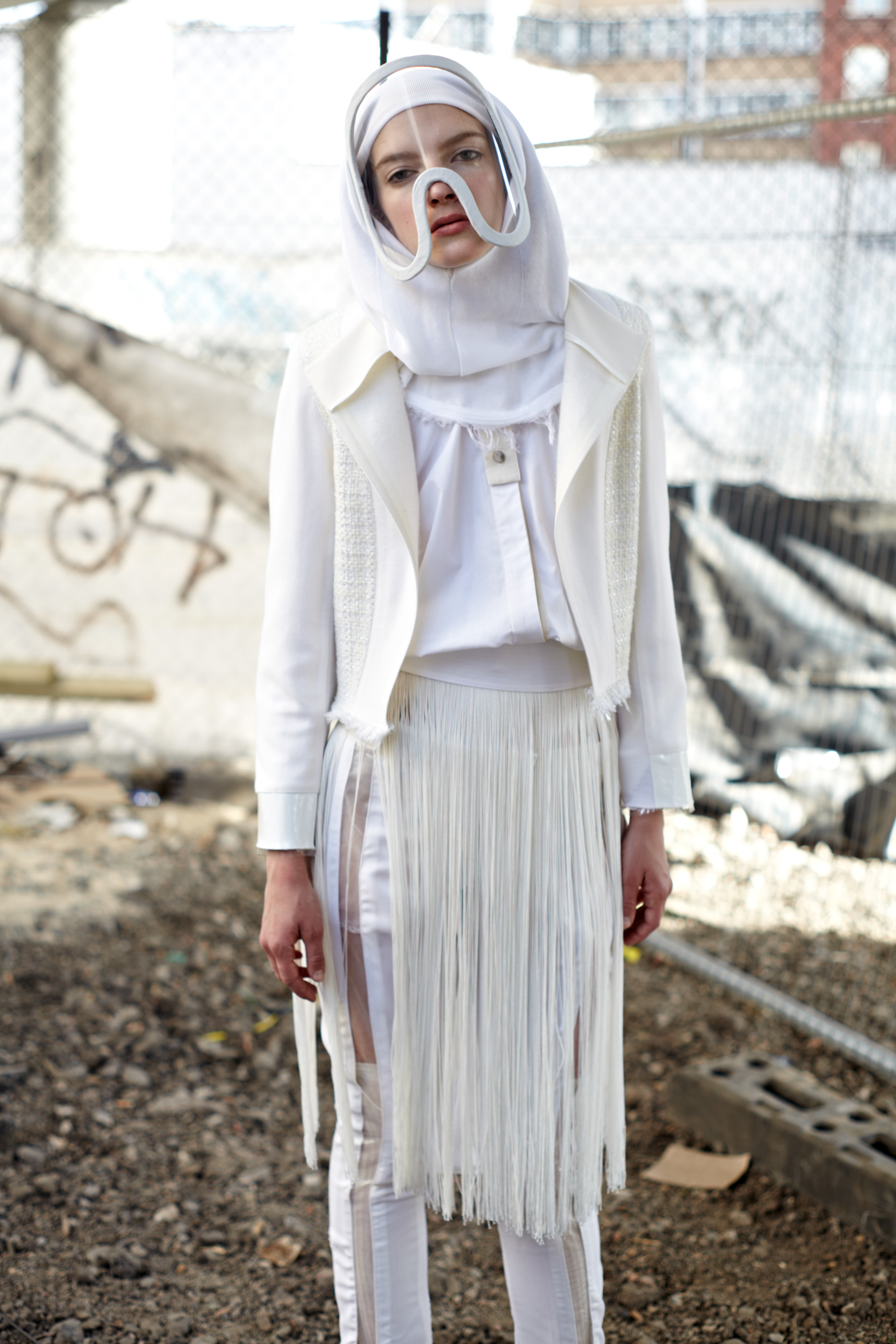 wool leather and plastic short jacket white fringed shirt antidote visors wool tailored trousers with plastic panels